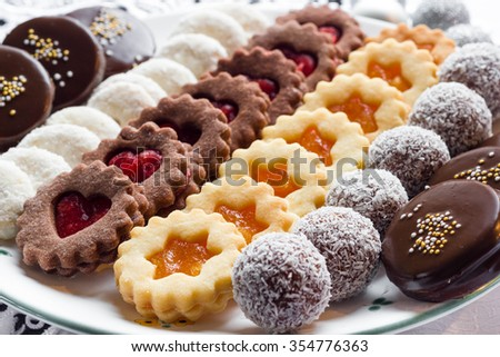 Mixed christmas cookies in line on a white plate. - stock photo