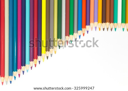 Mixed colours wooden pencil on white background - stock photo