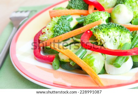 Mixed cooked vegetables on plate - stock photo