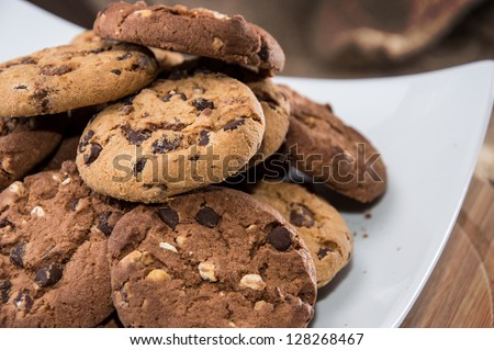 Mixed Cookies on a white plate - stock photo