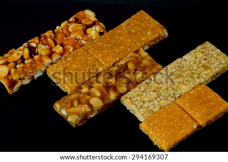 Mixed dry Fruit Cereal Bar on a  black background - stock photo