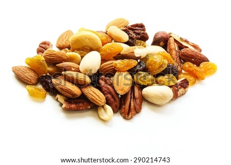 Mixed dry fruits and nuts isolated on white - stock photo