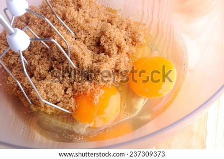mixed eggs and brown sugar - stock photo