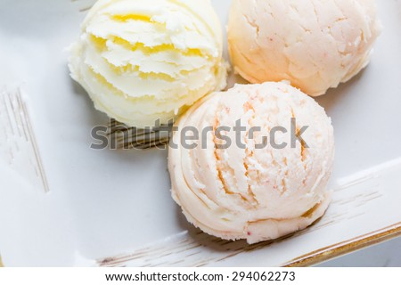 Mixed flavor ice cream scoops in bowl