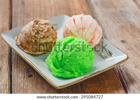 Mixed flavor ice cream scoops in plate  - stock photo