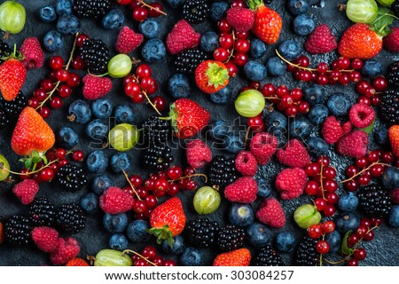 Mixed fresh ripe berries, food background from above - stock photo