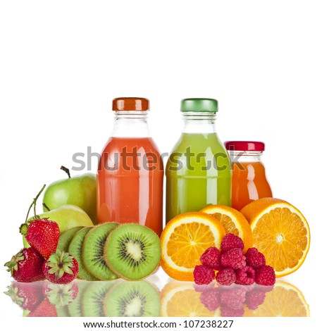 Mixed from many fresh fruits and juices in glasses on white - stock photo