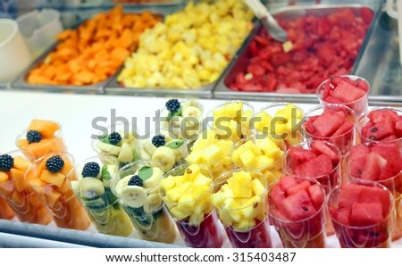 mixed fruit baskets and fruit salad for sale in summer - stock photo