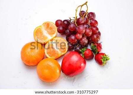 Mixed fruit , orange , grape , strawberry, berries , apples . - stock photo