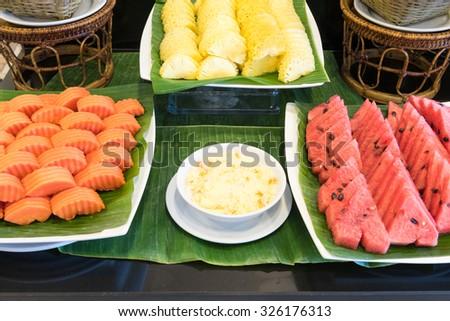 mixed fruit watermelon, papaya and pineapple and fruit salad. - stock photo