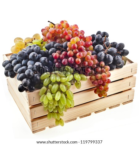 mixed grapes in a wooden crate box isolated on a white background - stock photo