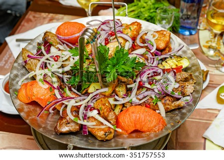 Mixed grilled and fried meat platter and vegetables - stock photo