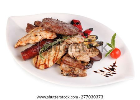 Mixed grilled meat platter. Mixed meat - Montenegrin cuisine. Meat on a white background. - stock photo