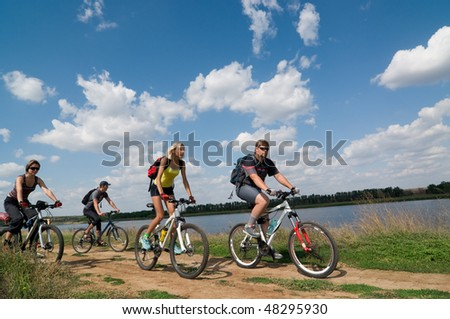 mixed group of cyclists - stock photo