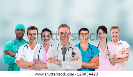 Mixed group of medical workers standing arms crossed in line - stock photo