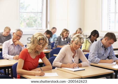 Mixed group of students in class - stock photo