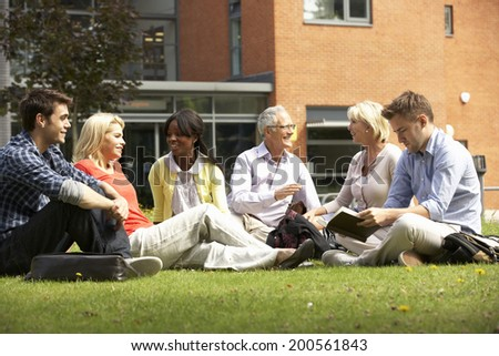 Mixed group of students outside college - stock photo