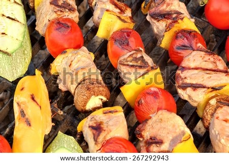 Mixed Kebabs BBQ On Hot Grill Background - stock photo