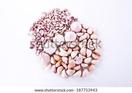 Mixed Kind of Fresh Garlic Cloves Bulb arranged in Round shape Isolated on white background. - stock photo