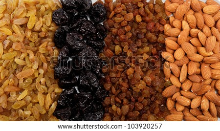 Mixed nuts and dried fruits. Almonds, raisins and prunes. - stock photo