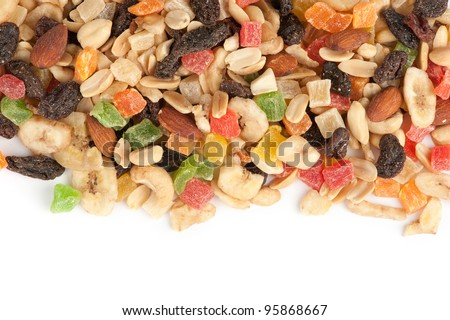 mixed nuts and dried fruits closeup - stock photo