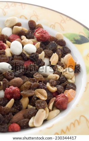 Mixed Nuts and Dried fruits in a Dish Close View - stock photo