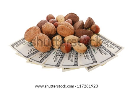 Mixed nuts in the shell with money selection of Brazil,almonds,walnut and hazelnuts isolated on white background - stock photo