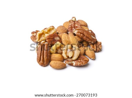 Mixed Nuts on White Background.  Isolated Walnuts, Pecans and Almonds. - stock photo