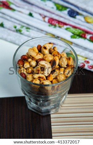 Mixed nuts. Variety of Mixed Nuts in glass. - stock photo
