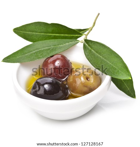 Mixed pickled olives with different kind of olives in a bowl on a white background - stock photo