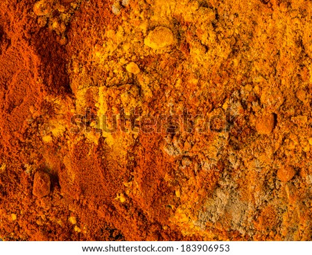Mixed powdered spices background - stock photo