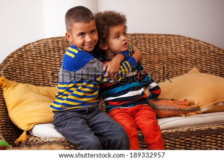 Mixed race boys are playing in living room - stock photo