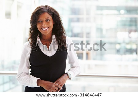 Mixed race businesswoman, waist up portrait - stock photo