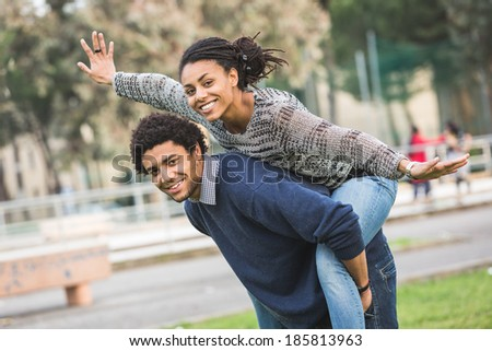 Mixed-Race Couple, Piggyback - stock photo