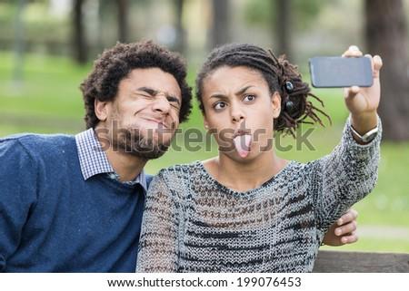 Mixed-Race Couple Taking Selfie - stock photo