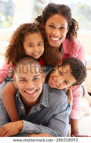 Mixed race family at home - stock photo