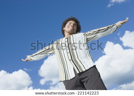 Mixed Race man with arms outstretched - stock photo
