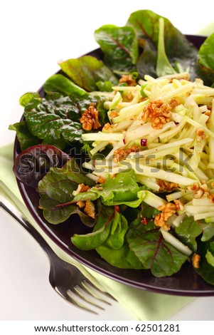 Mixed salad with kohlrabi, apples and walnuts on white isolated background - stock photo