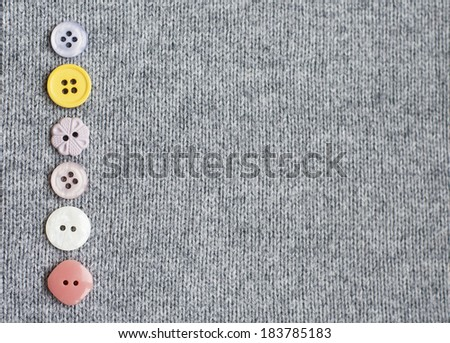 Mixed  Sewing Buttons on a knitting  background - stock photo