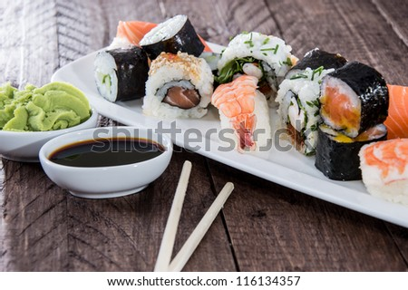Mixed Sushi on a plate with Soy Sauce - stock photo
