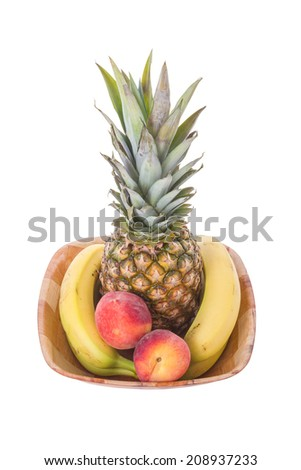 Mixed Tropical Fruits in a Wooden Fruit Bowl Isolated on a White Background - stock photo