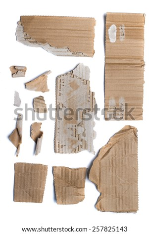 Mixed view of pieces of recycled brown cardboard. - stock photo