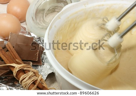 Mixer over bowl of cookie dough - stock photo