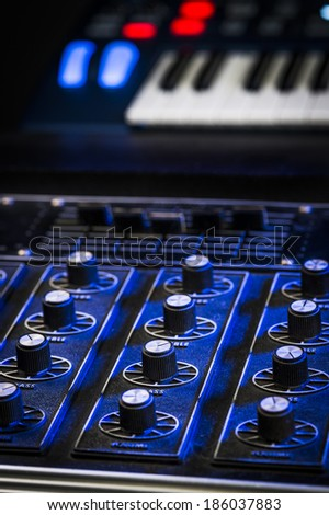 mixing board and synthesizer in a studio - stock photo