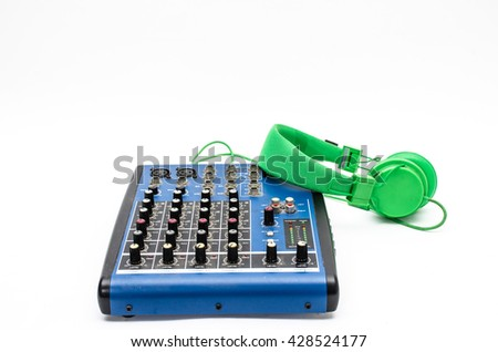 Mixing console and headphones. Element of music design. - stock photo