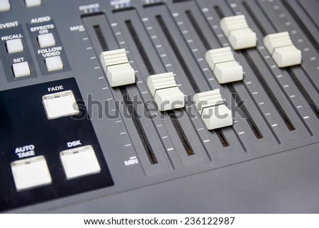 mixing console button switcher controlling broadcast - stock photo