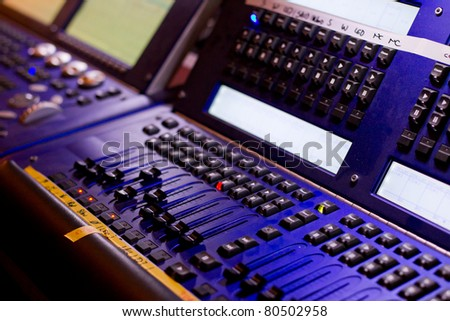 mixing desk with regulators, lamps, lights and different keys - stock photo