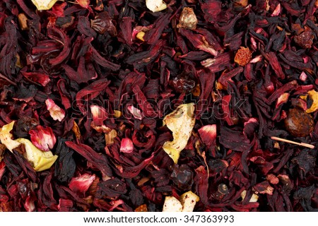 Mixture herbal floral fruit tea with petals, dry berries and fruits. Texsture. - stock photo