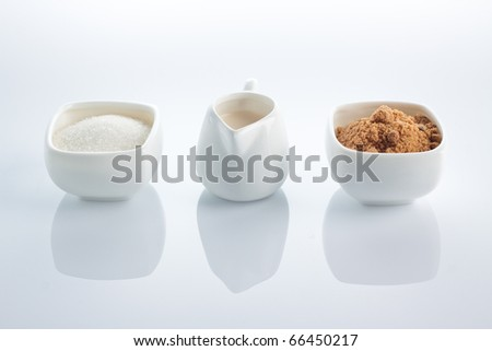 Mixture of brown and white sugar with milk for coffee. - stock photo
