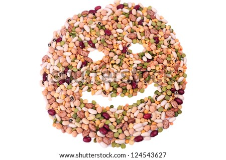 Mixture of dried lentils, peas, soybeans, legumes, beans isolated on white. Smile face made from mixture of legumes - stock photo